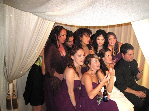 bride, groom and bridal party together in the Lounge