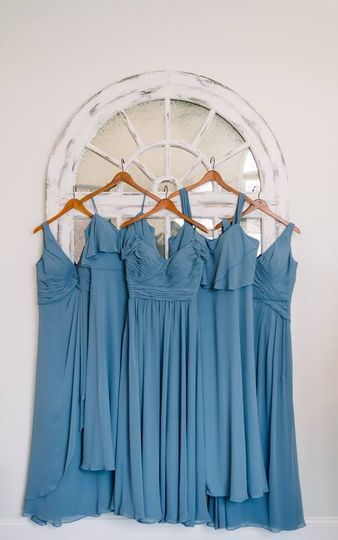 Lovely blue dresses hung up in the parlor
