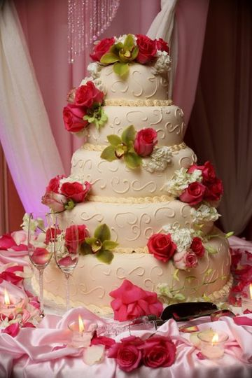 Wedding cake decorated with hot pink roses