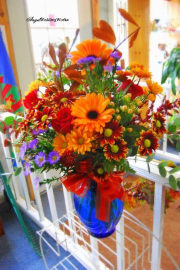 Orange gerbera, blue iris and autumn tablepieces