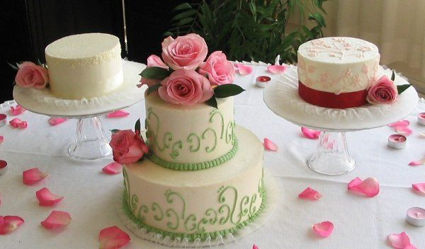 This bride wanted her wedding cakes to also serve as a centerpiece. She chose three designs and we...