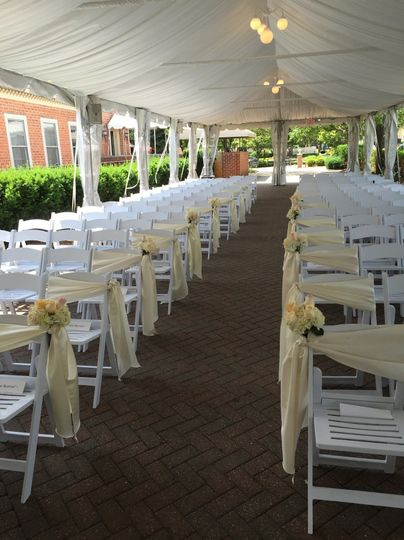 outdoor ceremony white chairs