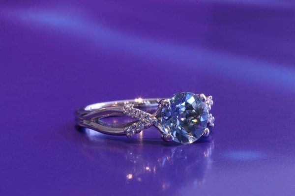 Custom Aquamarine engagement ring with a sprinkle of diamonds on each side.