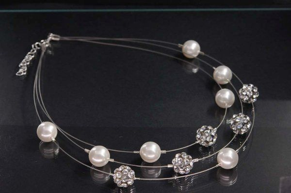 Swarovski Crystals and Pearls float on 3 strands of invisable wire