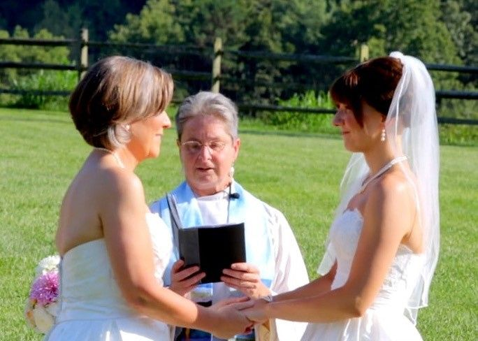 Couple with officiant