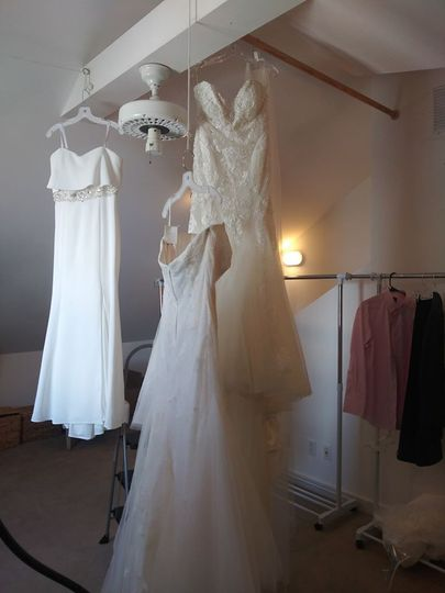 Wedding gowns pressed and hung