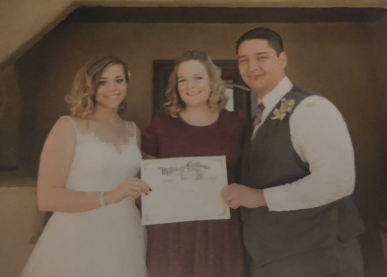 Showing off their marriage certificate