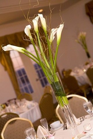 white calla lilies & curly willows will give the decent look