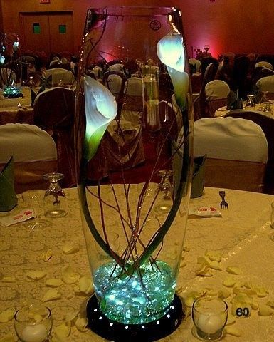 this is very simaple but elegant centerpiece with light inside the calla lilies with lighted base
