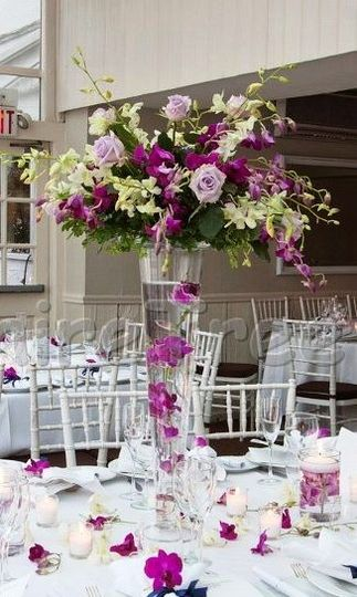 purple & white orchids & purple roses
