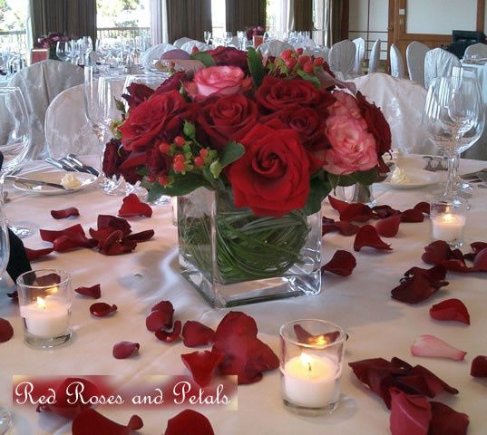 red roses and berries in square vase would be nice alter table centerpiece