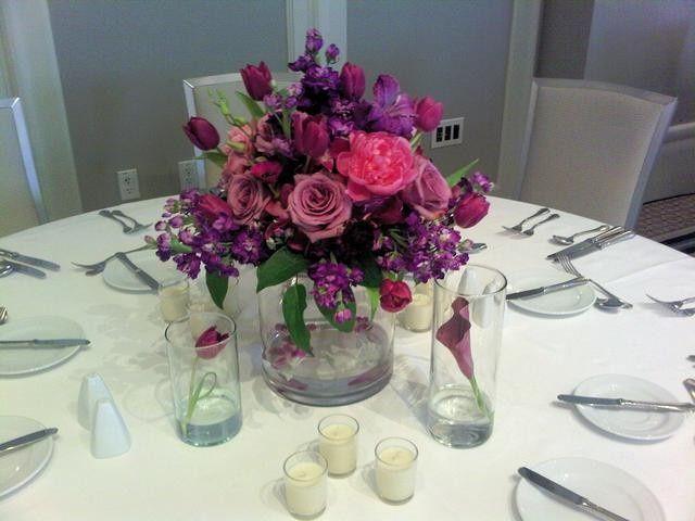 Beautiful low arrangement with purple Stocks, Roses.
