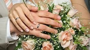hands wedding rings