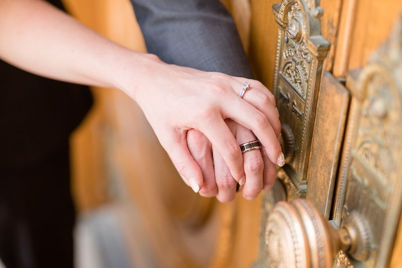 Bride and groom ring shot on the handles of the Salt Lake Temple