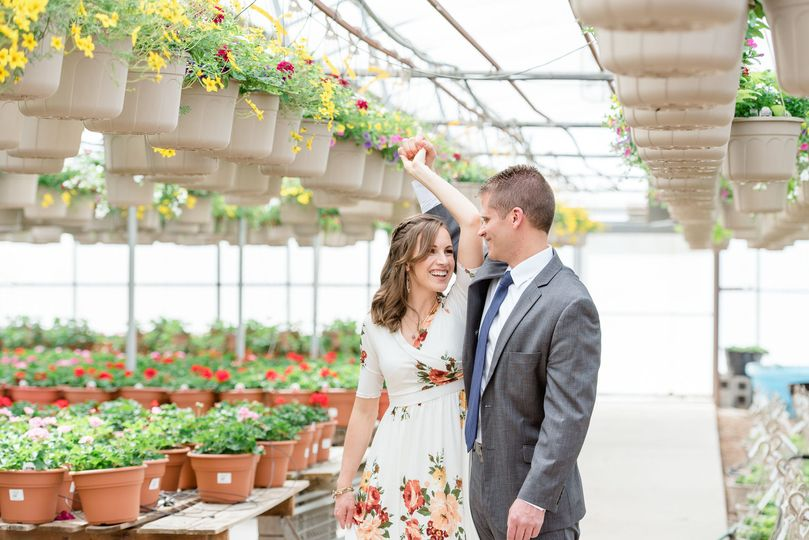 Couple inside of a greenhouse