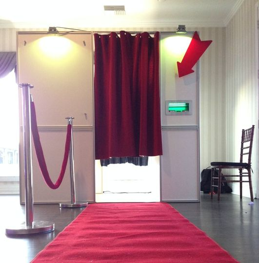 Red carpet traditional photobooth setup.