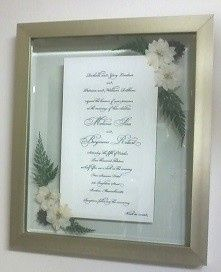 Wedding invitation in corners design mounted in the brushed gold frame.
