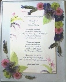 Wedding invitation with daisies, lavender and lime green skeletonized leaves prior to being framed.