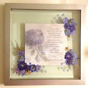 Wedding invitation mounted in brushed gold frame.