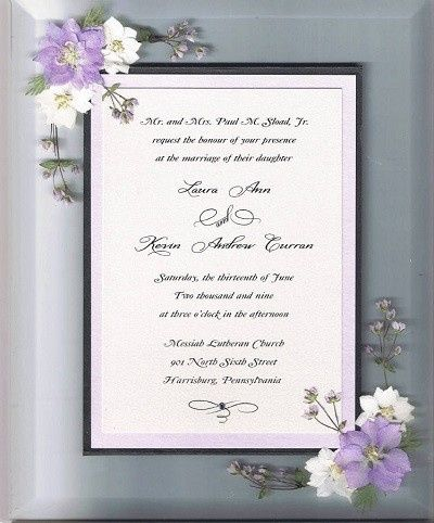 Wedding invitation with larkspur flowers prior to being framed.