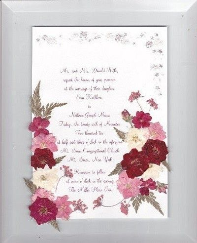 Wedding invitation with red roses and larkspur prior to being framed.