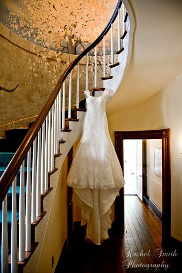 Wedding gown hanging on the staircase