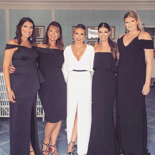 Bride and her bridesmaids in sleek dresses