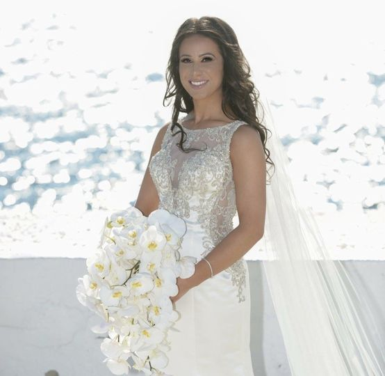 Bride in a sleeveless wedding gown