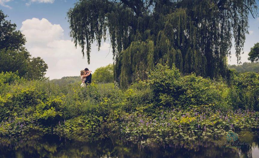 Kissing beneath a tree