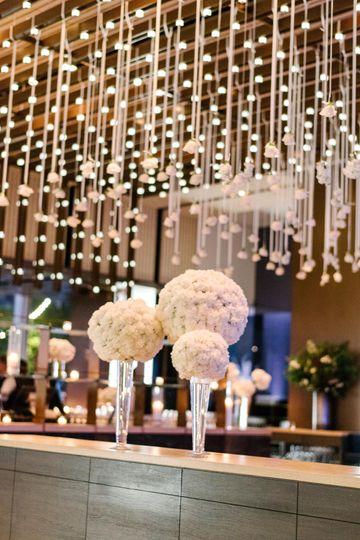 stefanie jon wedding entrance table arrangements carnation pomander ball on pilsner vase riverpark nyc by trent bailey 0709 51 159499 v1