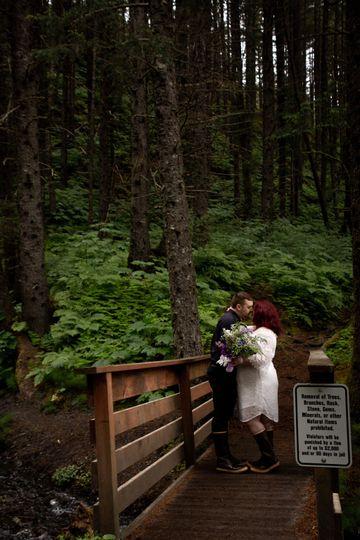 Couple kissing on a bridge