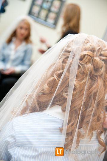 Elegant curls under veil