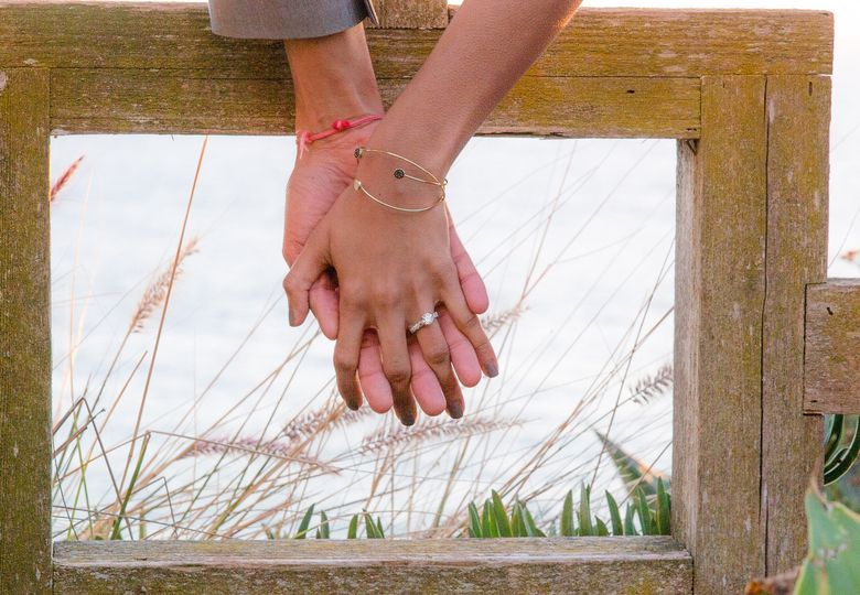 Wedding ring on full display as the lovely couple lock hands