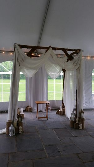 Rustic red cedar arch available for rent in the MD/DC/VA metro area.  The arch can be decorated with...