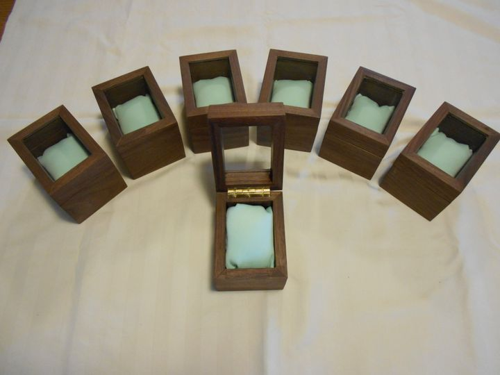 Handcrafted walnut watch boxes with a brass-hinged glass top and a pillow matching the wedding...