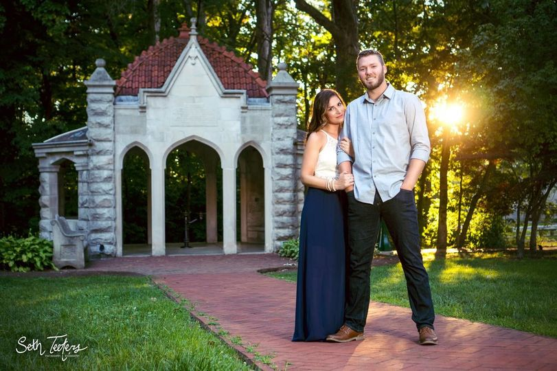 Engagement session portrait taken at the Rose Well House on IU campus.