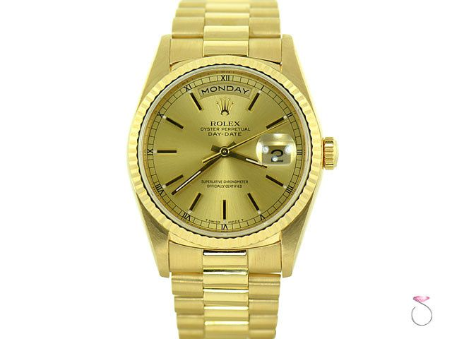 Elegant Rolex Day Date President 18K yellow gold watch. The case diameter is 36 mm with scratch...