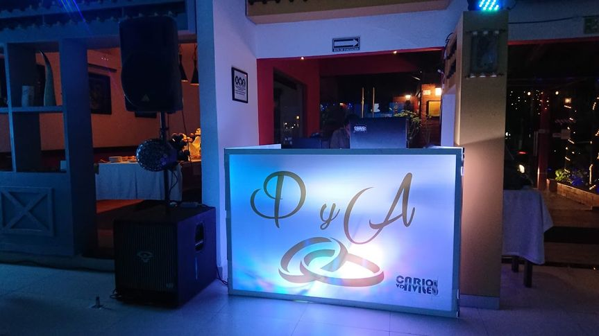 DJ booth illuminated by a custom monogram spotlight