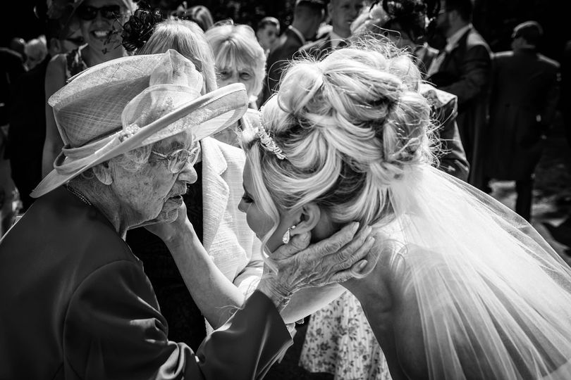 Bride and Great Grandma touch