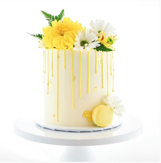 Yellow floral drip cake