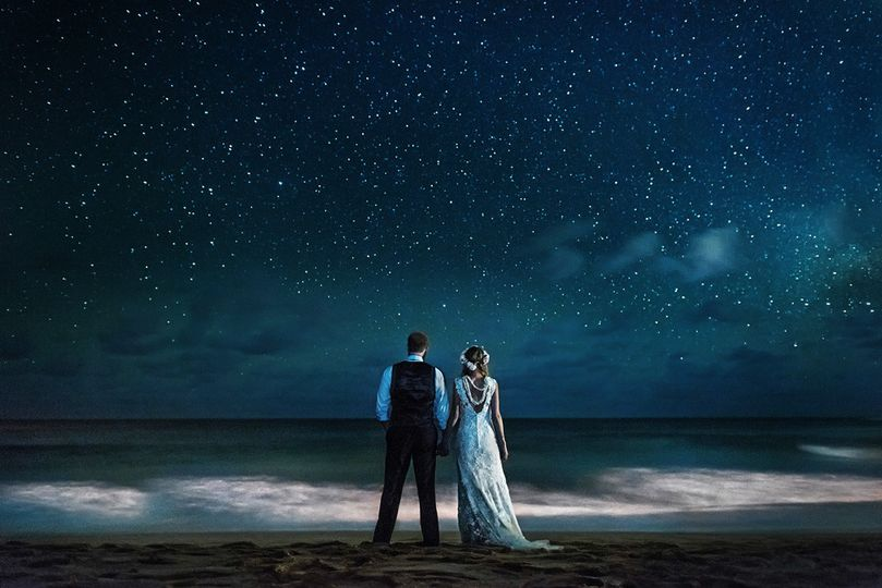 Hawaii wedding couple getting photographed under the stars.