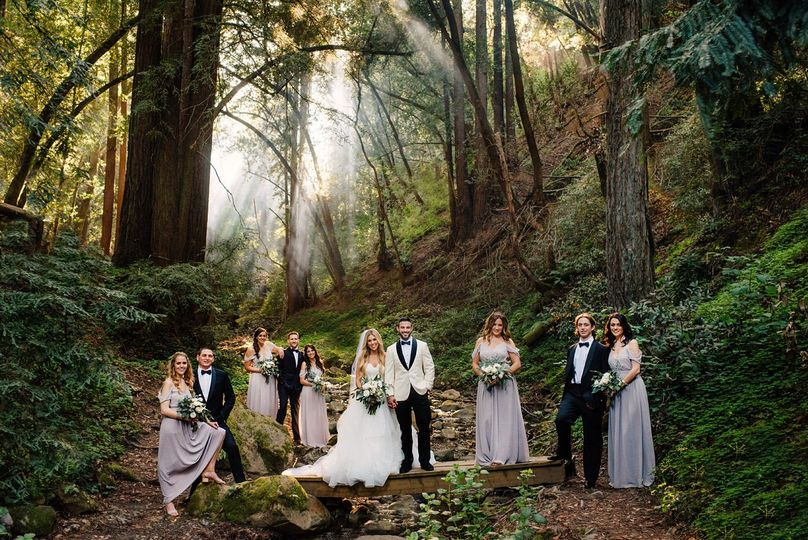 mountain wedding party with couple in the forest