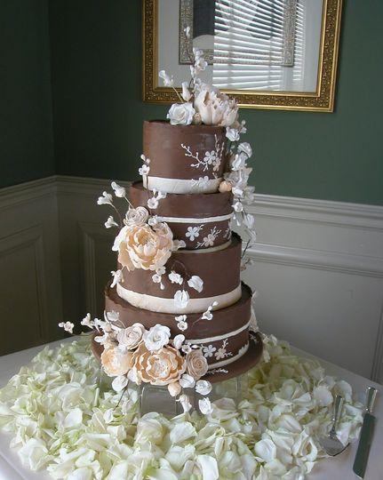 Custom designed Sugar Flowers adorn this chocolate fondant covered wedding cake