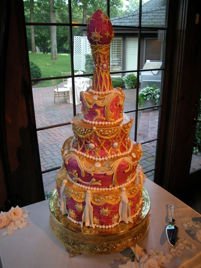 Carved, Russian themed, Italian Buttercream wedding cake decorated with handmade sugar work.