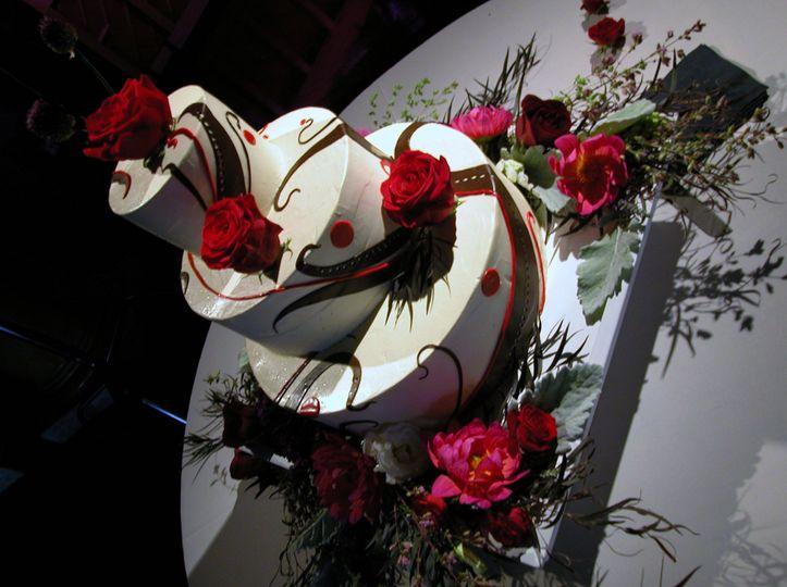 Chocolate decorated Italian Buittercream wedding cake finfished with fresh flowers