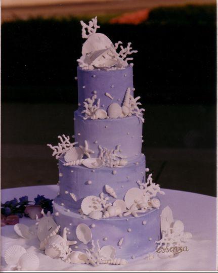 Custom Handmade Sugar Seashells decorate this Italian Buttercream wedding cake