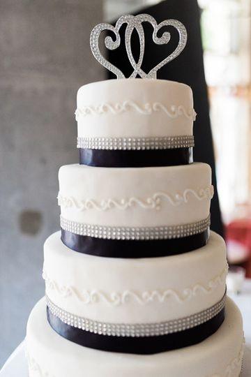 5 tier round fondant cake with glam ribbon and plum ribbon. Double heart topper