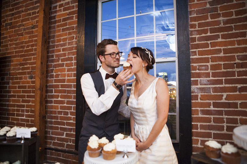 Couple eating Connie Cakes Amaretto Italian Cream Cupcakes.