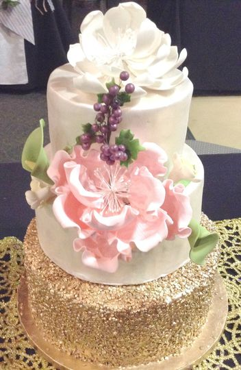 A 3 tier Nashville Wedding Cake covered in fondant. A gold sequine tier with peony flower and...