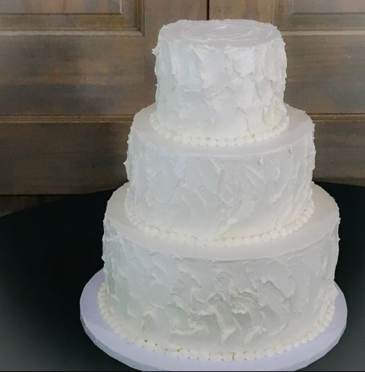3 tier nashville wedding cake decorated simple with white buttercream